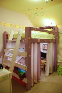 A girl's loft bed with ladder and lighted workspace underneath